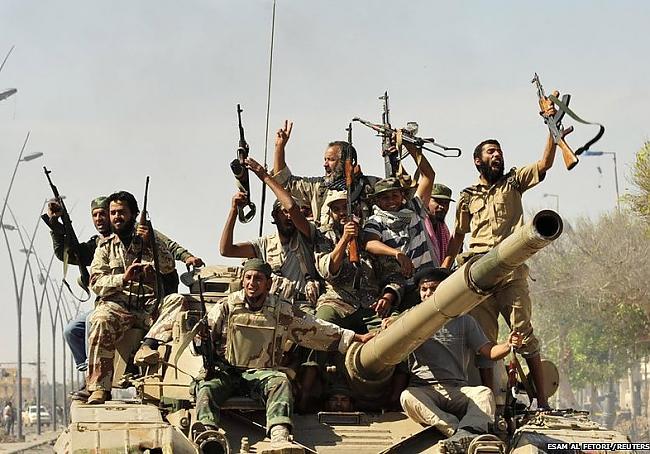 Cilvēki visā Lībija svin ziņas... Autors: žeņa Week in pictures: 15-21 Oktobris